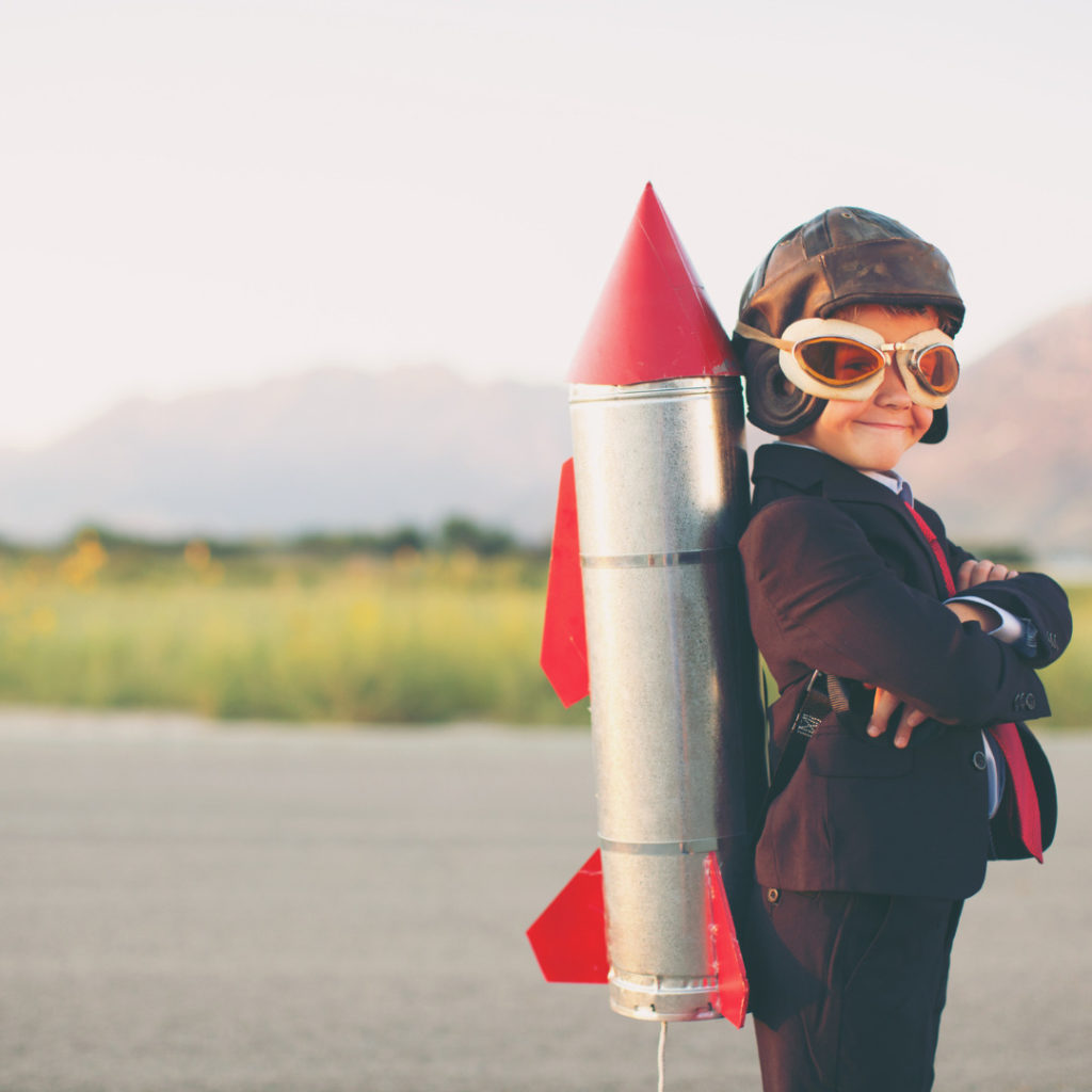 young business boy with rocket on back picture id8336870361